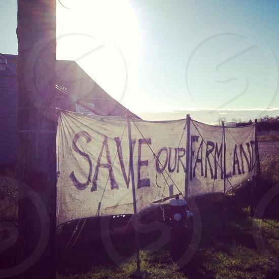 Save our Farmland banner near house photo