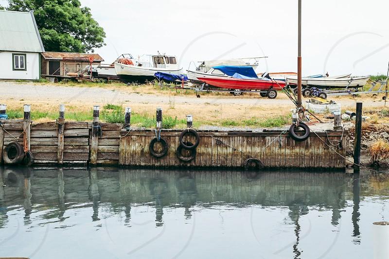 Boating life boats boat shore railing engines water photo