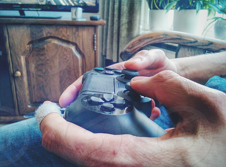 Playing in the PlayStation 4 photo
