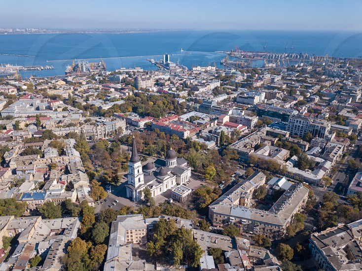 Panoramic view of the city of Odessa from Spaso-Preobrazhensky Cathedral and sea port on a background of blue sky. Ukraine. Aerial view from the drone photo