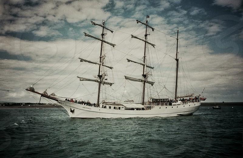 Elegant old 3 masted white hulled sailing ship at sea.... photo