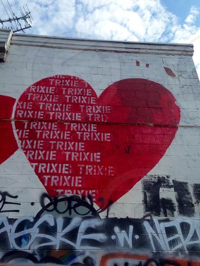 red heart graffiti with white trixie print photo