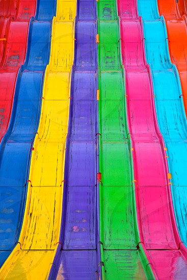 orange teal pink green purple yellow blue and red slides photo