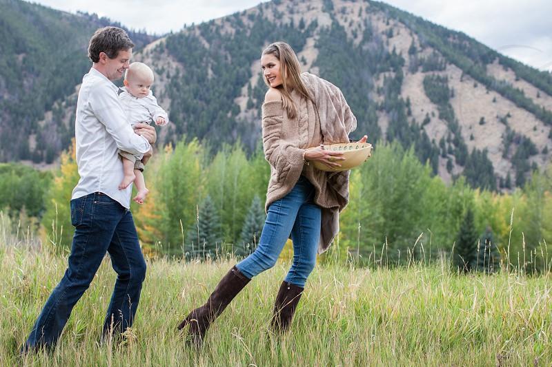 Young couple outdoors picnicking enjoying life. photo