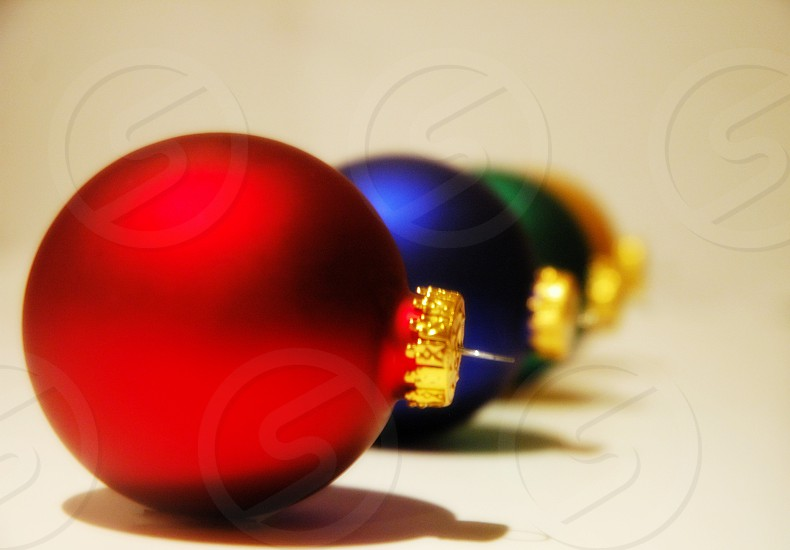 red blue green and orange christmas balls photo