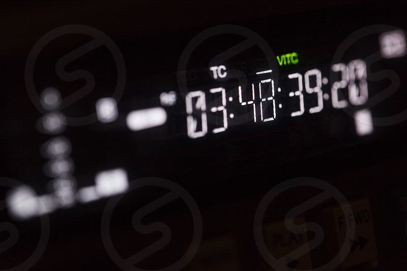 Timecode running on the professional video recorder. Macro shot with perspective. photo