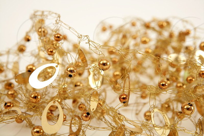 golden jewel messy wired texture balls and oval gold shapes photo