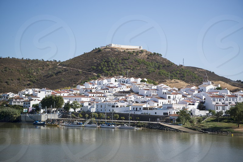 town Sanlucar de Guadiana in Spain at the river Rio Guadiana on the Border of portugal and Spain at the east Algarve in the south of Portugal in Europe. photo