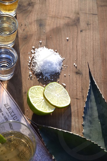 Triple Tequila salt lime agave sunlit outside shots drinks copy space. photo