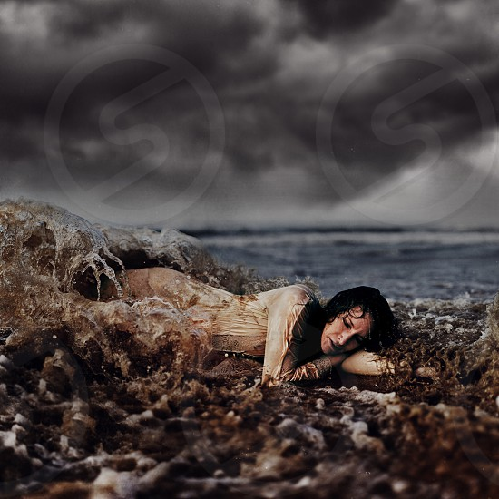 woman lying near the seashore photo