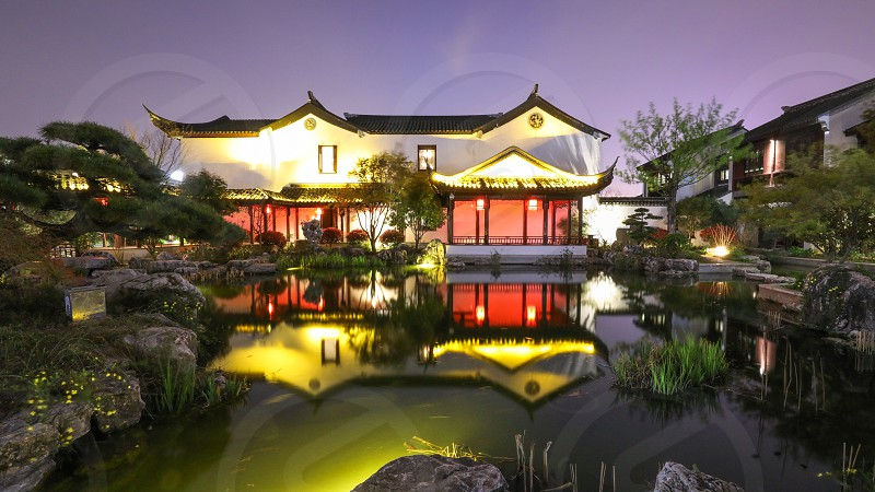 China suzhou xietang building light reflection park photo