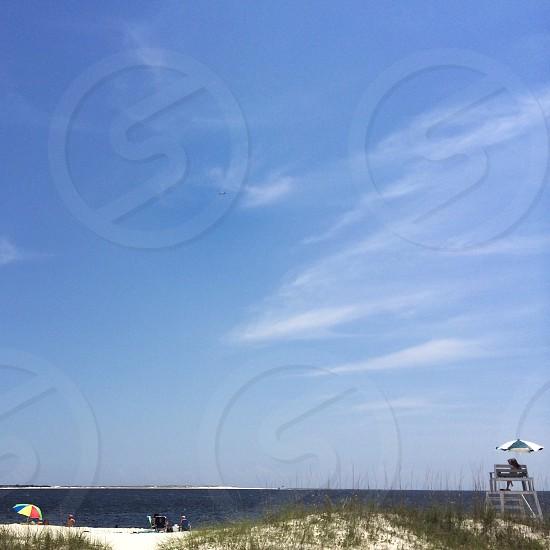 view of blue skies and ocean water photo