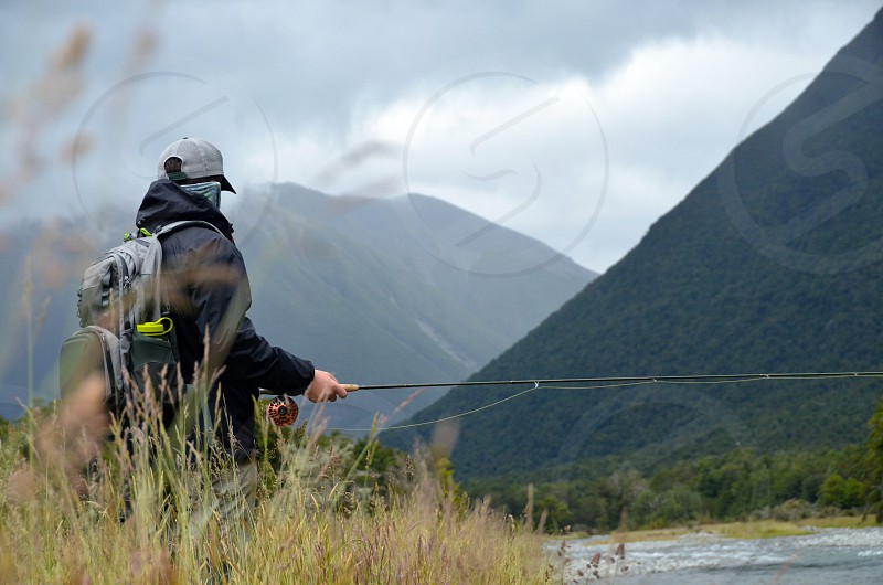 Streamside looking for trout New Zealand photo