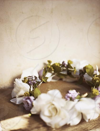 A simple set of wedding rings set on top of a brides floral headband.  soft;wedding;rings;flowers;floral;bride;film;film scan; photo