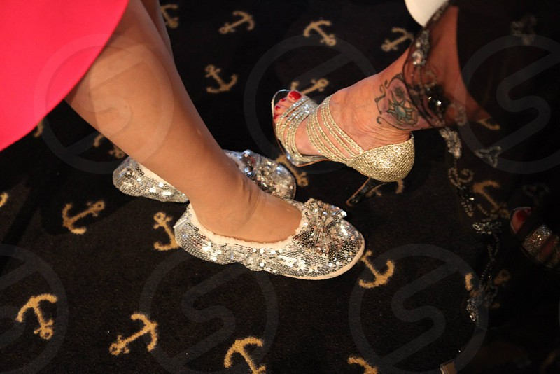 woman in brown and silver glitter flats photo