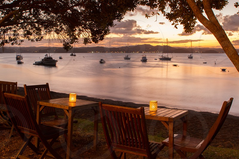 The outside tables of The Gables Restaurant overlooking the Bay of Islands in Russell New Zealand photo
