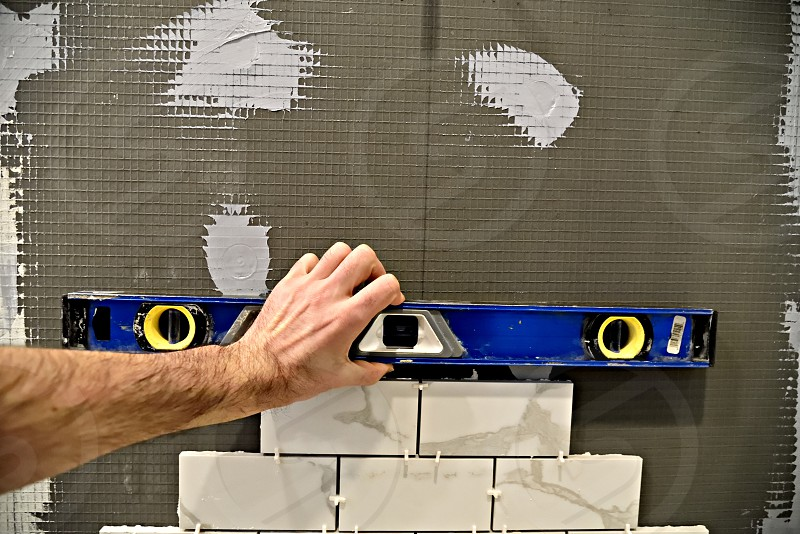 Tiling bathroom wall level photo