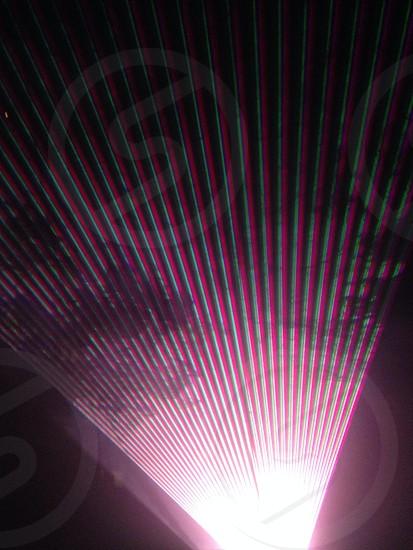 purple led lights hitting fog during night photo