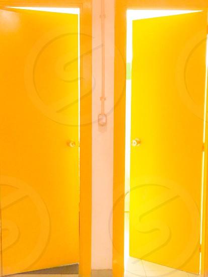 Yellow doors open equal light bright symmetrical lock knob photo