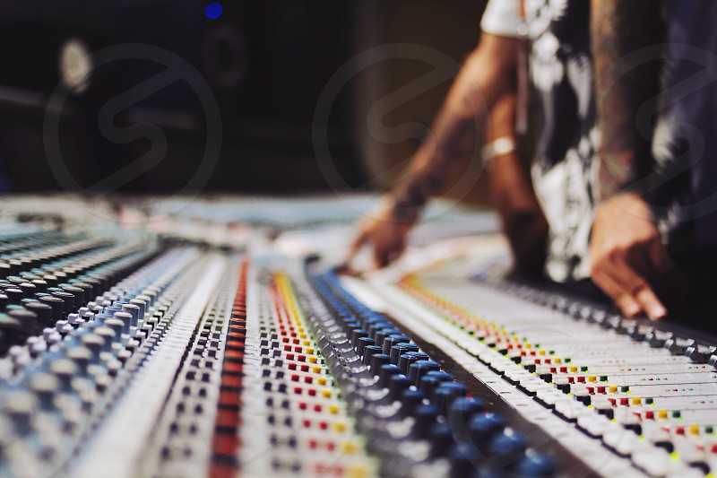 people using sound mixing table photo
