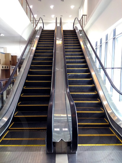 black and yellow escalator and white recessed light photo