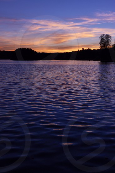 Calm waters at sunset photo