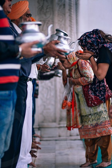 Clean water being poured into hands photo