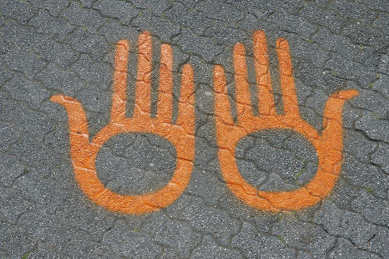 concrete floor with orange hand paint photo