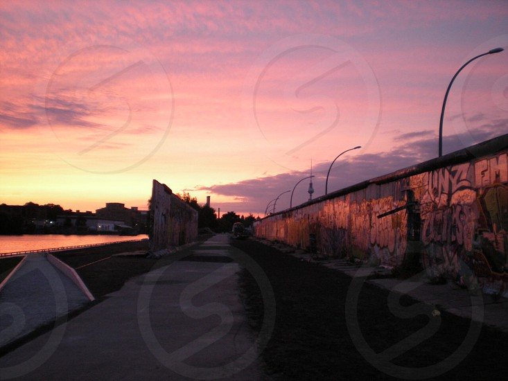 graffiti art wall under clouded sky during sunset photo