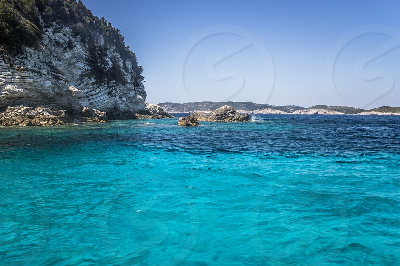 Beautiful Island of Paxos in the Ionian Sea with its blue caves on the western shore. photo