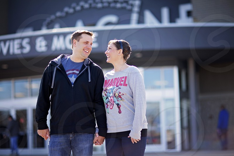 A couple on a date at a movie theatre photo