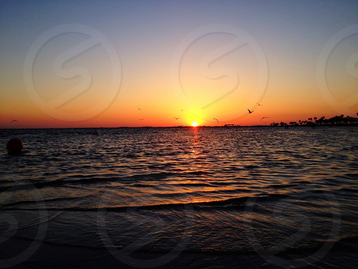 sea with sunset photo