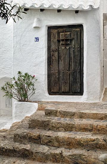 An antique wooden door entrance into an old fisherman's house. Binibeca Menorca photo