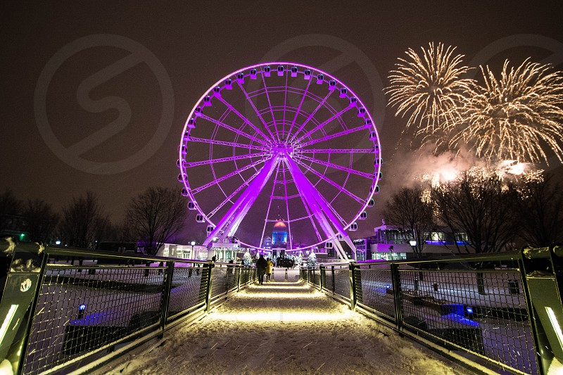 The great wheel in Montreal changes color often but violet really is its best color! photo