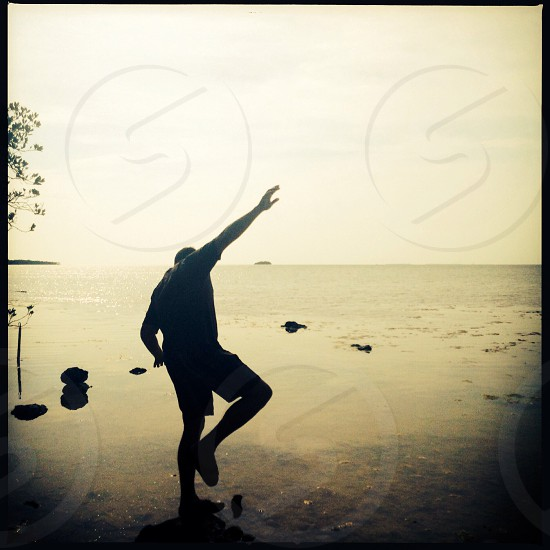 Balancing man photo