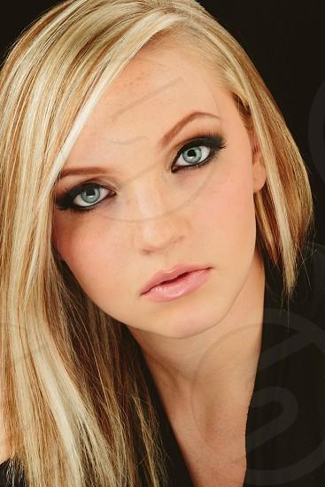 Portrait woman blonde blue eyes model headshot  photo