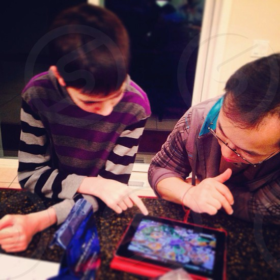 Explaining how to play an iPad game photo
