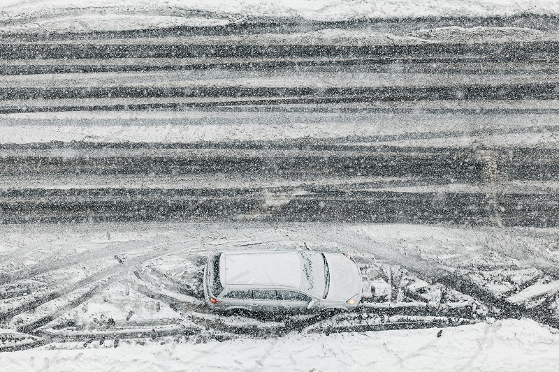Car parked on the street in a snowy weather photo