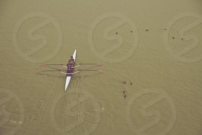 two men rowing a boat photo