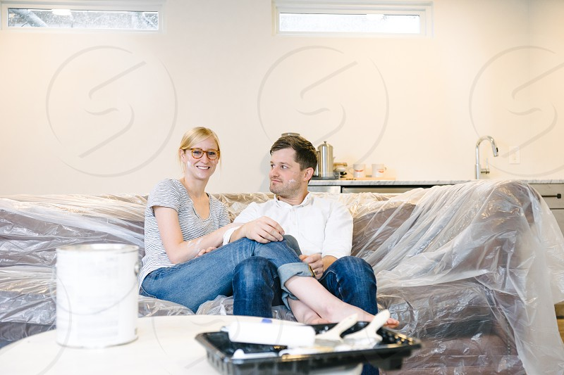Young married couple having fun renovating their home. photo