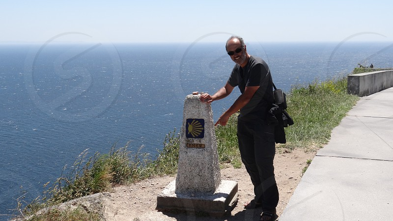 Ending the way to Santiago de Compostela Finisterre Spain. Atlantic Ocean. photo
