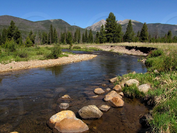 Rocky Mountains Colorado river stream mountain water rocks trees sky  photo
