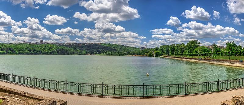 Embankment of Valea Morilor Lake in Chisinau Moldova on a sunny summer day photo