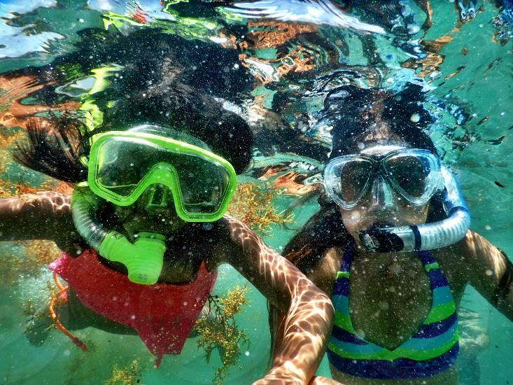 Kids snorkeling Red Reef in Boca Raton Florida photo