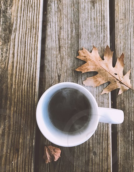 Drink; coffee; coffee cup; steam; leaves; wood; natural photo