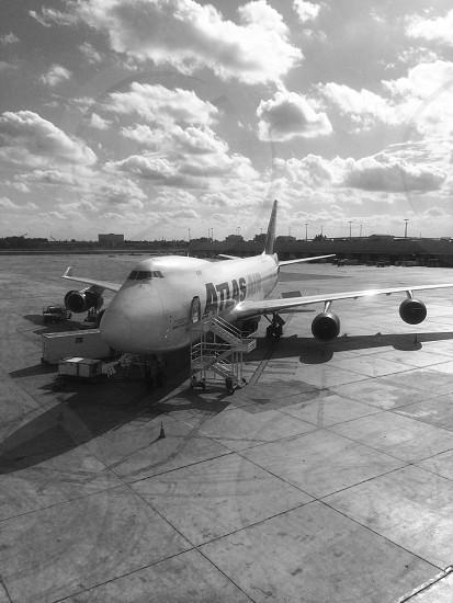 white and black airplane landing photo