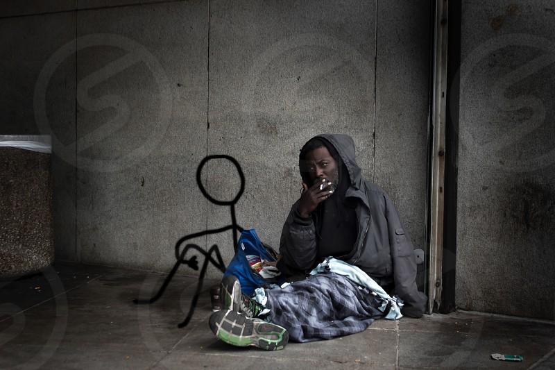 Homeless alone sad art stickman company cigarette smoke cold lonely poor man photo