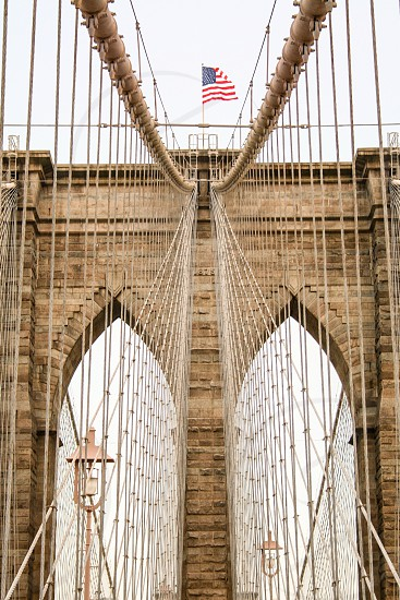 Brooklyn bridge New York american flag photo