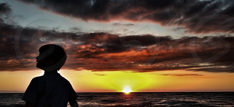 boy on sunset view photography  photo