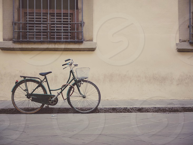 Bicycle parked on the road in Florence Italy. photo
